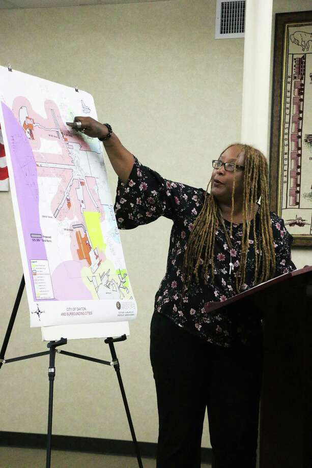 Kimberly Judge, assistant city manager and director of planning for the city of Dayton, points out the four locations she recommended the city annex. Council approved the resolution and set a calendar for the annexation. Photo: David Taylor