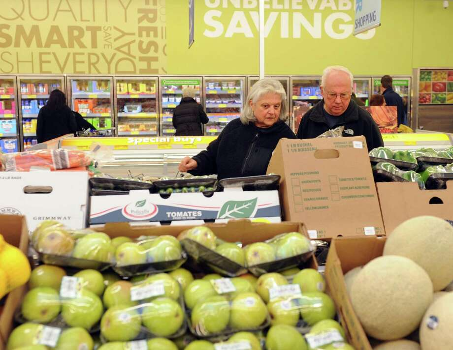 Ann Marie and John Checkley shop at the new ALDI supermarket in Derby, Conn. Thursday, Dec. 11, 2014. The couple has been traveling to West Haven for years to shop at the grocery chain's location there and are glad to have an ALDI's so close to home. Photo: Autumn Driscoll / Autumn Driscoll / Connecticut Post