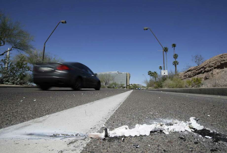 A vehicle goes by the scene of a fatality where a pedestrian was stuck by an Uber vehicle in autonomous mode, in Tempe, Ariz. A self-driving Uber SUV struck and killed the woman in suburban Phoenix in the first death involving a fully autonomous test vehicle. Photo: Chris Carlson /Associated Press / Copyright 2018 The Associated Press. All rights reserved.