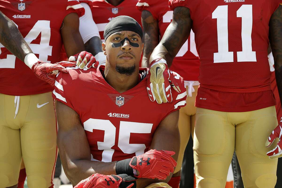 San Francisco 49ers safety Eric Reid (35) kneels in front of teammates during the playing of the national anthem before an NFL football game between the 49ers and the Carolina Panthers in Santa Clara, Calif., Sunday, Sept. 10, 2017. (AP Photo/Marcio Jose Sanchez)