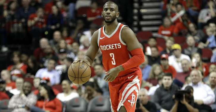 Houston Rockets guard Chris Paul (3) brings the ball up court against the San Antonio Spurs during the second half of an NBA basketball game Monday, March 12, 2018, in Houston. (AP Photo/David J. Phillip)