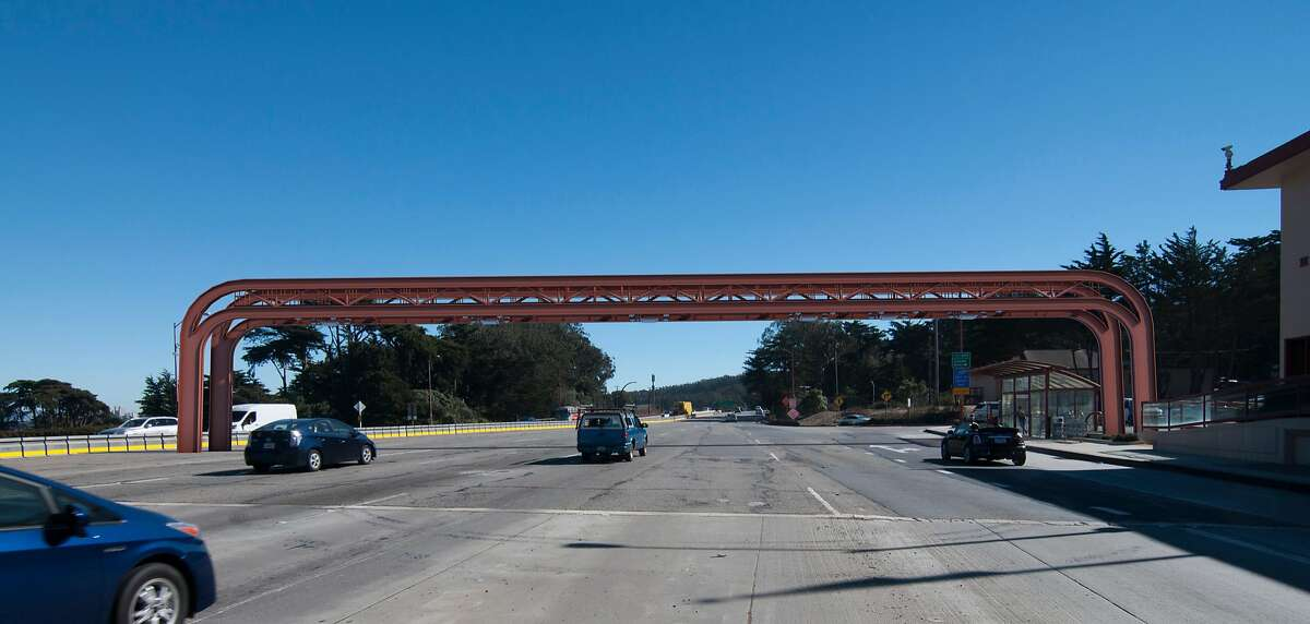 Three possible designs for a new toll gantry at the Golden Gate Bridge incorporate elements of the span.