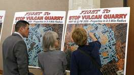 Audience examine posters before the beginning of TCEQ Public Meeting on proposed Vulcan Materials quarry in Comal County on Tuesday, February 27, 2018 at New Braunfels Civic Center