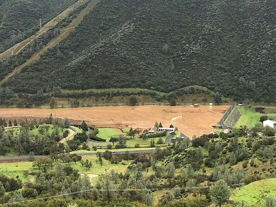 Moccasin Reservoir Dam in the Sierra foothills on Wednesday. Officials warned the dam is in imminent danger of failing. Photo: Tuolumne County Sheriff's Department