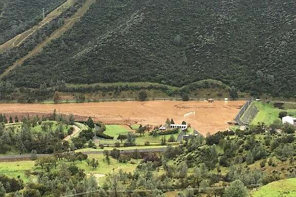Moccasin Reservoir Dam in the Sierra foothills on Wednesday. Officials warned the dam is in imminent danger of failing.