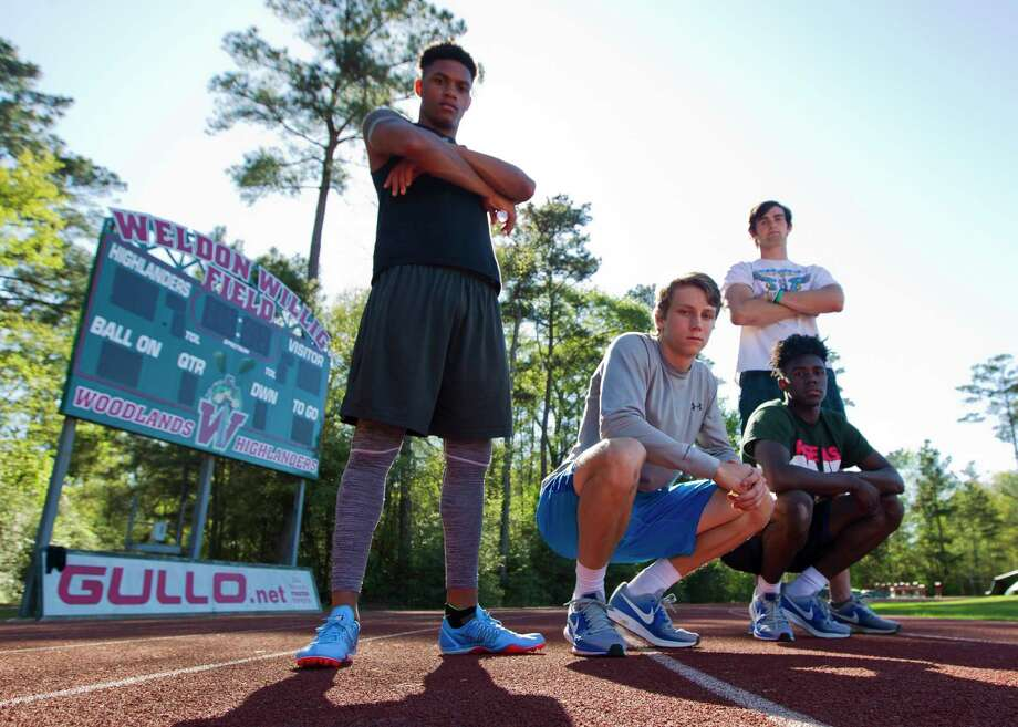 From left to right: DeAngelo Alexander,  Jake Lanier, Ethan Bonner, bottom left, and KeSean Carter poses for a portrait, Tuesday, March 20, 2018, in The Woodlands. The varsity relay team broke the school's record 4 x 100 meter school record during the Dan Green Invitational on March 6. Photo: Jason Fochtman, Staff Photographer / © 2018 Houston Chronicle