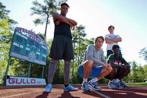 From left to right: DeAngelo Alexander,  Jake Lanier, Ethan Bonner, bottom left, and KeSean Carter poses for a portrait, Tuesday, March 20, 2018, in The Woodlands. The varsity relay team broke the school's record 4 x 100 meter school record during the Dan Green Invitational on March 6.