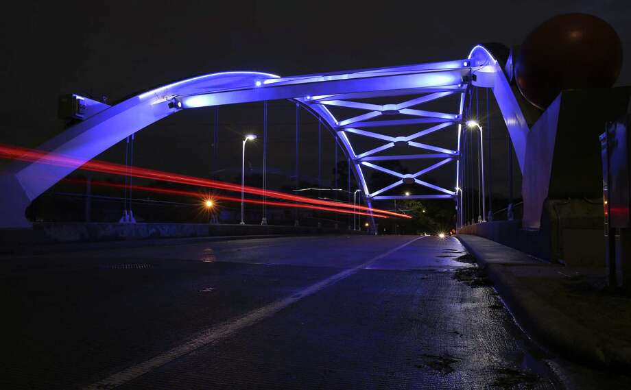 Lights are turned back on bridges over the Southwest Freeway in Montrose at sunset on Saturday, Jan. 27, 2018, in Houston. The lights were turned off on January 19 because the Montrose Management District  could not pay the utility bill while under a temporary court order. ( Yi-Chin Lee / Houston Chronicle ) Photo: Yi-Chin Lee, Houston Chronicle / Houston Chronicle / © 2018  Houston Chronicle
