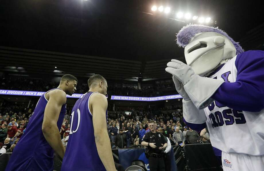 Iggy, the now-expelled mascot and logo of the College of the Holy Cross in Worcester, Mass., claps during an NCAA college basketball game in 2016. Photo: Young Kwak, Associated Press