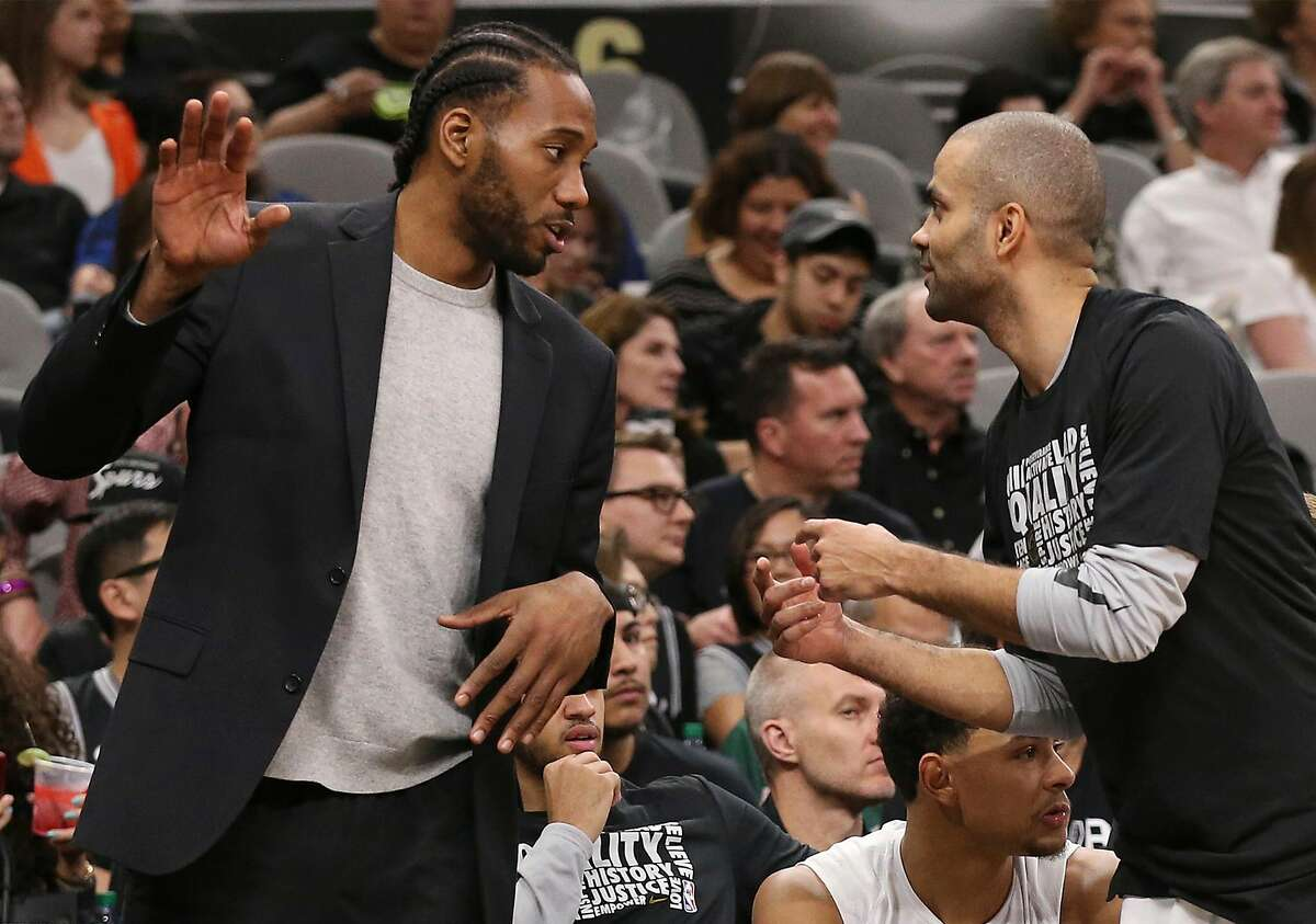 San Antonio Spurs� Tony Parker talks with Kawhi Leonard during the second half against the New Orleans Pelicans at the AT&T Center, Wednesday, Feb. 28, 2018. The Spurs lost, 121-116.