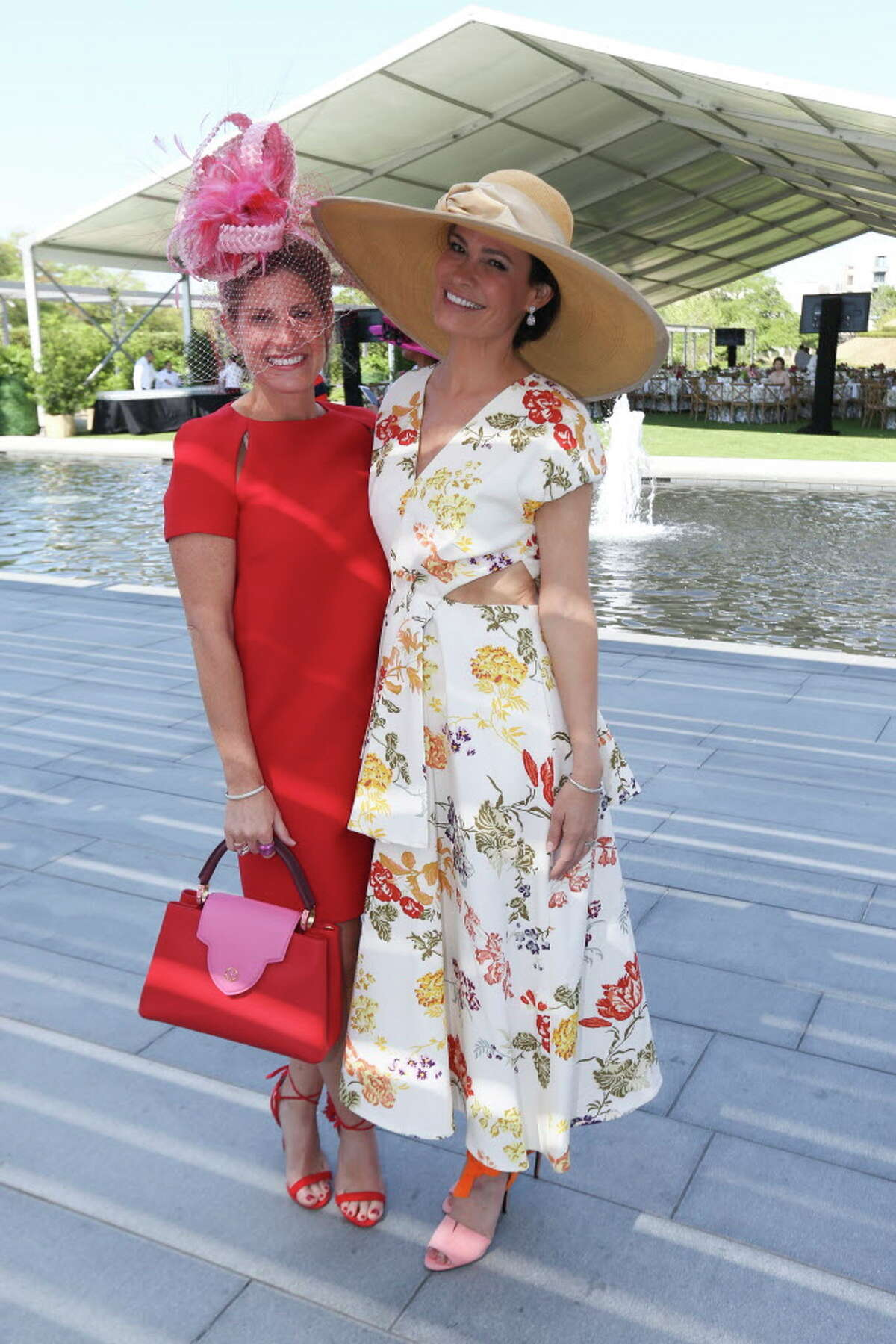 Hats in the Park luncheon chairs Greggory Burk, left, and Francine Ballard pose for a photograph at the Cherie Flores Garden Pavilion on Thursday, March 22, 2018, in Houston.