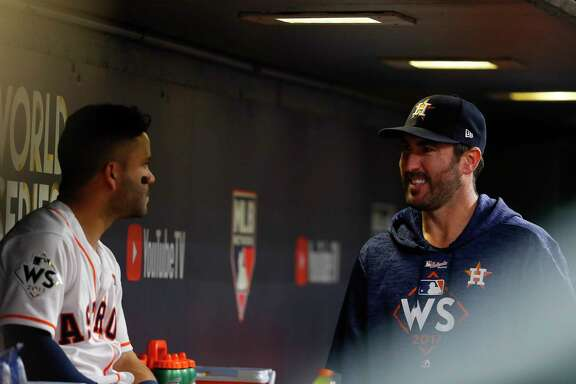 Houston Astros second baseman Jose Altuve (27) talks to Justin Verlander (35) in the dugout during Game 4 of the World Series at Minute Maid Park on Saturday, Oct. 28, 2017, in Houston. ( Karen Warren  / Houston Chronicle )