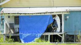 Federal agents continue to investigate the home of the Austin Bomber suspect in Pflugerville, Texas on Thursday, March 22, 2018. (Ricardo B. Brazziell/Austin American-Statesman/TNS)