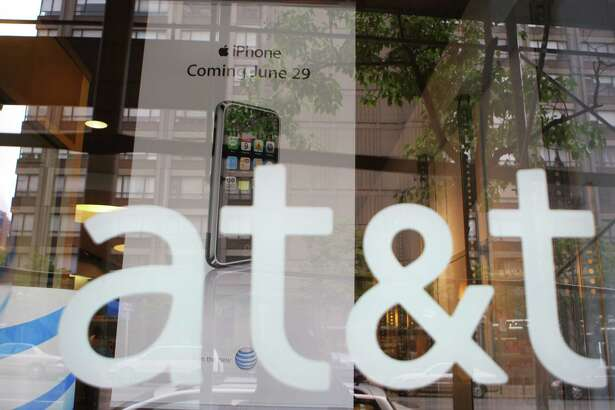 A 2007 file photo of an AT&T store front logo in New York.