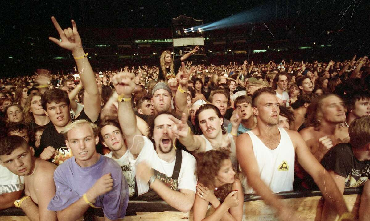 Fans show their support during Metallica's Day on the Green performance at the Oakland Coliseum on Oct. 12, 1991.
