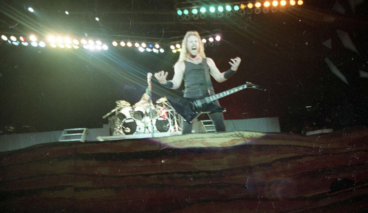 Singer/guitarist James Hetfield shows his enthusiasm during Metallica's Day on the Green performance at the Oakland Coliseum on Oct. 12, 1991.