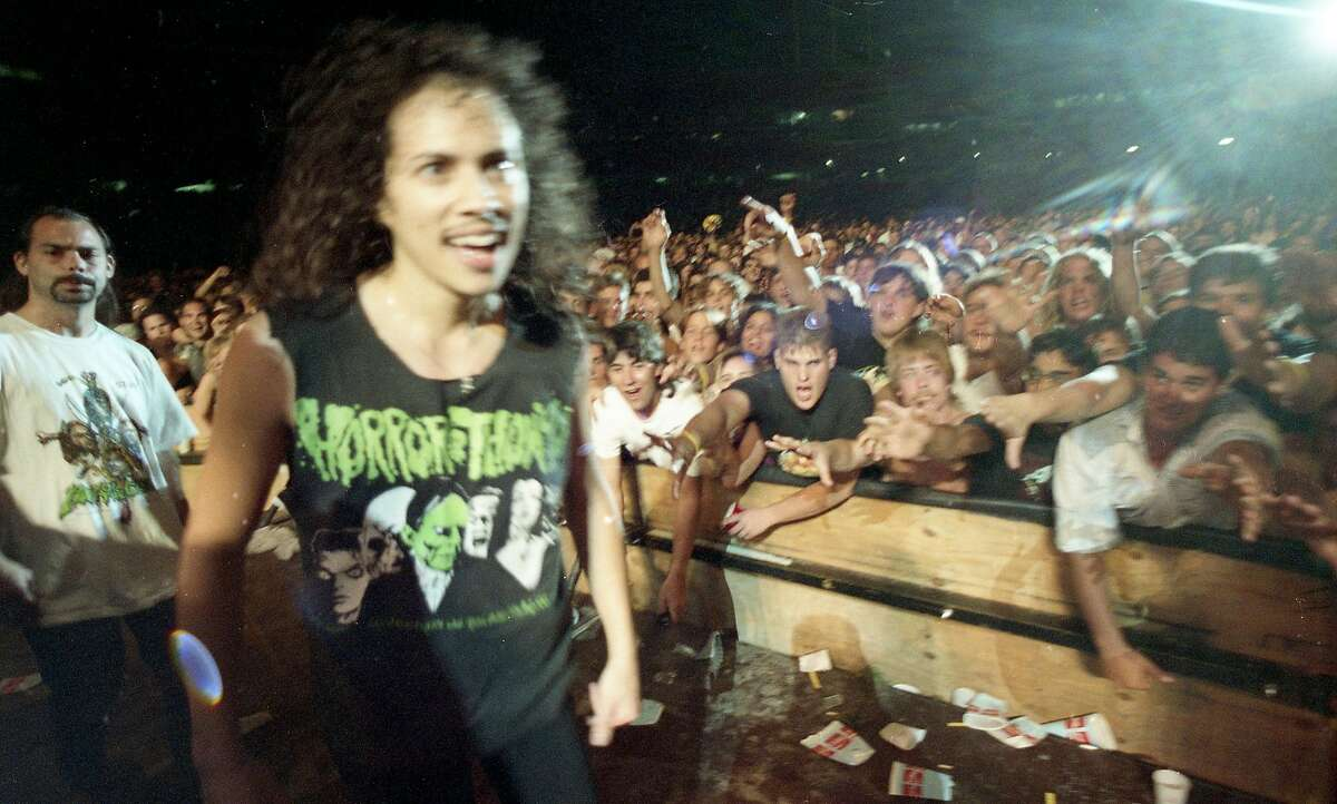 Kirk Hammett greets the crowd before Metallica's rowdy Day on the Green performance at the Oakland Coliseum in 1991.