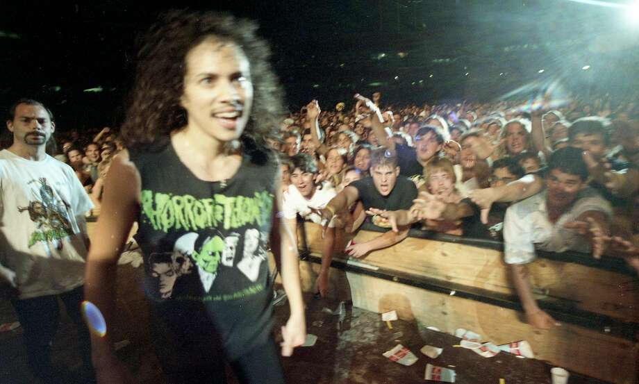 Kirk Hammett greets the crowd before Metallica's rowdy Day on the Green performance at the Oakland Coliseum in 1991. Photo: Ron Riesterer, The Chronicle