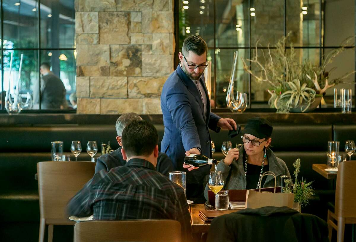 People have dinner at Charlie Palmer Steak in Napa, Calif., on March 17th, 2018.