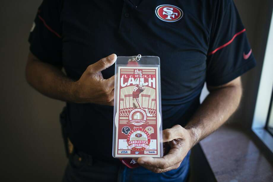 Solomon Burke shows his ticket stub from the final game at Candlestick Park, where the San Francisco 49ers defeated the Atlanta Falcons. Photo: Annie Flanagan, Special To The Chronicle