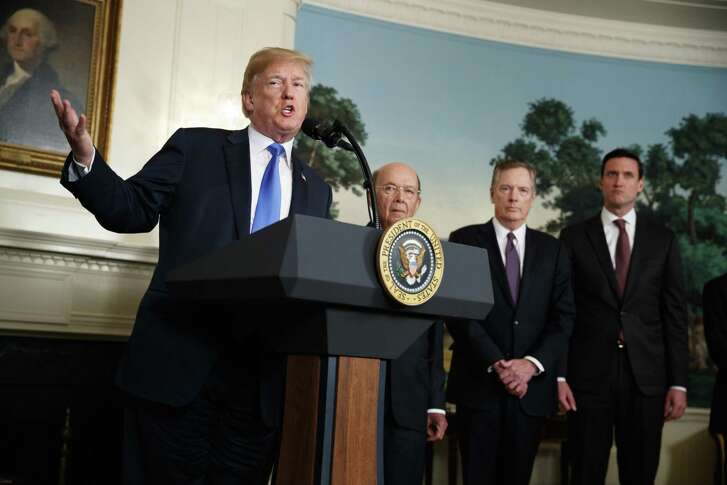 President Donald Trump speaks before signing a Presidential Memorandum imposing tariffs and investment restrictions on China, in the Diplomatic Reception Room of the White House, Thursday, March 22, 2018, in Washington. From left, Trump, Secretary of Commerce Wilbur Ross, United States Trade Representative Robert Lighthizer, and White House homeland security adviser Tom Bossert. (AP Photo/Evan Vucci)