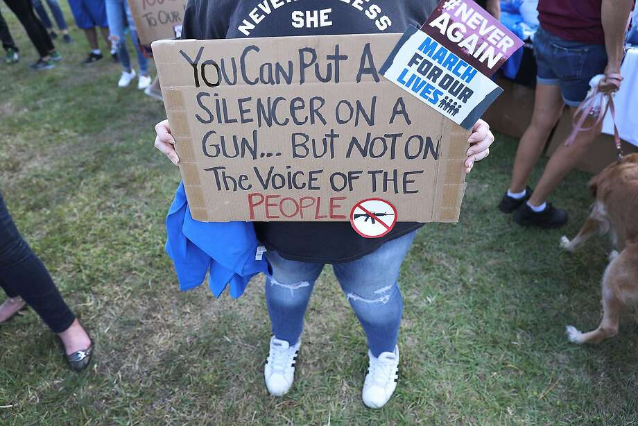 Sophie Phillips holds a sign as she attends a rally for those heading to the March for Our Lives event in Washington D.C., on March 20, 2018 in Parkland, Florida. The rally was held in the name of the 17 students and school staff killed on Valentine's Day at Marjory Stoneman Douglas High School. Photo: Joe Raedle, Getty Images