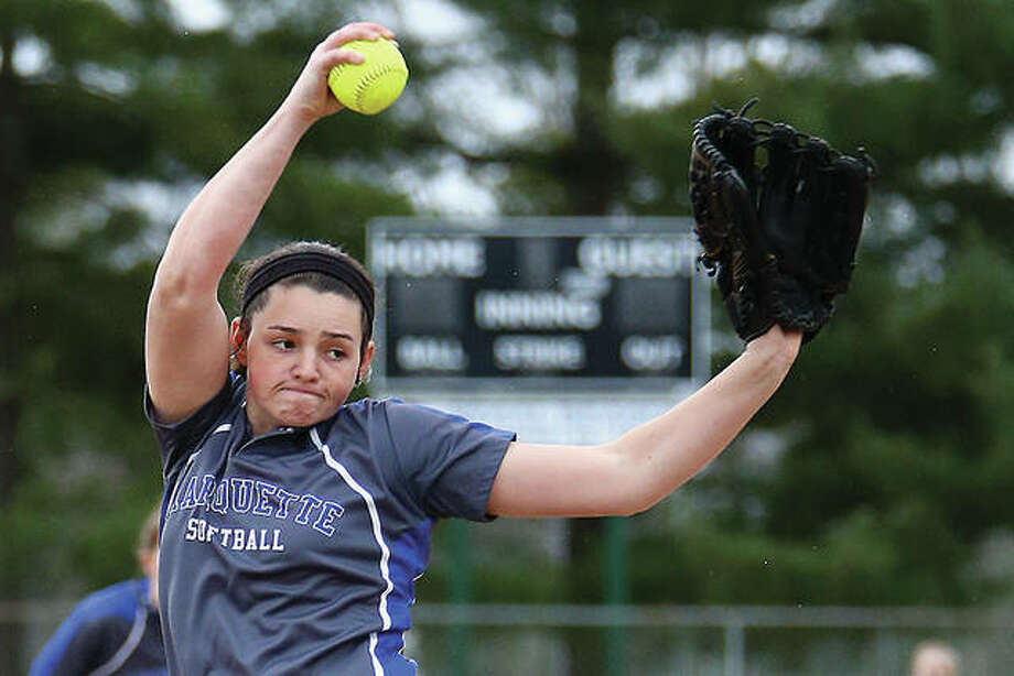 Marquette Catholic High pitcher Meghan Schorman delivers a pitch to a Gillespie batter during Thursday's game at Gordon Moore Park. Schorman pitched a two-hitter and struck out 11 in a 5-0 Explorers victory. Photo: Billy Hurst | For The Telegraph