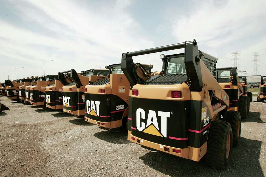 FILE - JULY 24: According to reports on July 24, 2014, Caterpillar Inc reported higher second quarter profits than were expected, but posted lower sales in the global market, offsetting a rebound in North America. ELMHURST, ILLINOIS - APRIL 24:  Caterpillar earth moving equipment is displayed at Patten Industries on April 24, 2006 in Elmhurst, Illinois. Heavy equipment maker Caterpillar reported first-quarter earnings higher than forecasted at $840 million, up 45 percent from $581 million during the same period in 2005. (Photo by Scott Olson/Getty Images) ORG XMIT: 57408379 Photo: Scott Olson / 2006 Getty Images