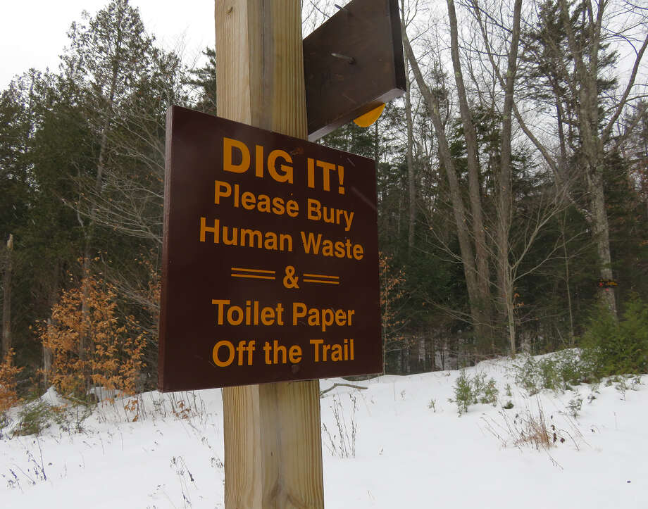 A sign near Upper Works in the Adirondack Park is part of the fight against toilet paper blooms. (Herb Terns/Times Union) Photo: Picasa