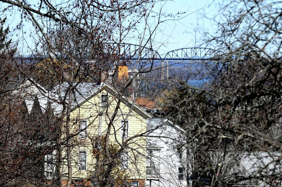 The Castleton Bridge is seen through the trees and homes on James Drive on Monday, March 19, 2018, in Coeymans, N.Y. (Will Waldron/Times Union)