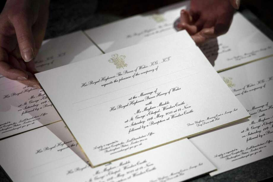 Invitations for the wedding of Britain's Prince Harry and US actress Meghan Markle are pictured, after they have been printed at the workshop of Barnard and Westwood in London on March 22, 2018. / AFP PHOTO / POOL / Victoria JonesVICTORIA JONES/AFP/Getty Images Photo: VICTORIA JONES / AFP