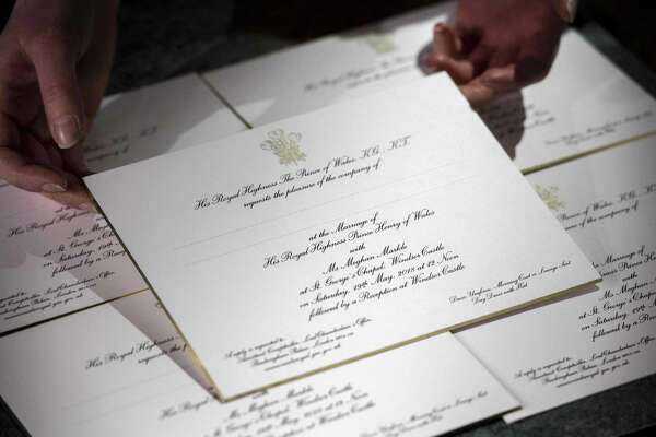 Invitations for the wedding of Britain's Prince Harry and US actress Meghan Markle are pictured, after they have been printed at the workshop of Barnard and Westwood in London on March 22, 2018. / AFP PHOTO / POOL / Victoria JonesVICTORIA JONES/AFP/Getty Images