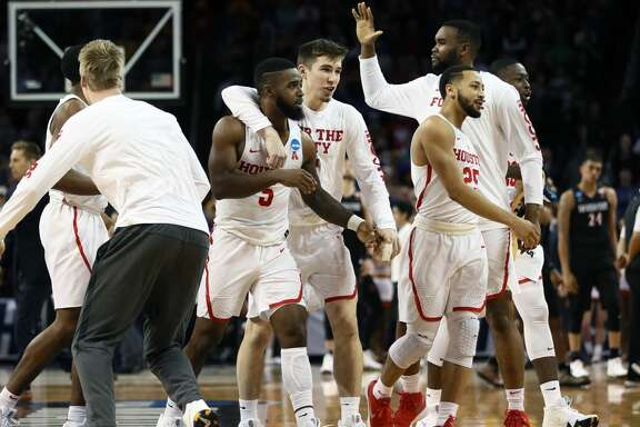 WICHITA, KS - MARCH 15:  The Houston Cougars celebrate their win over the San Diego State Aztecs in the first round of the 2018 NCAA Men's Basketball Tournament at INTRUST Arena on March 15, 2018 in Wichita, Kansas. The Houston Cougars defeated the San Diego State Aztecs 67-65.  (Photo by Jamie Squire/Getty Images)