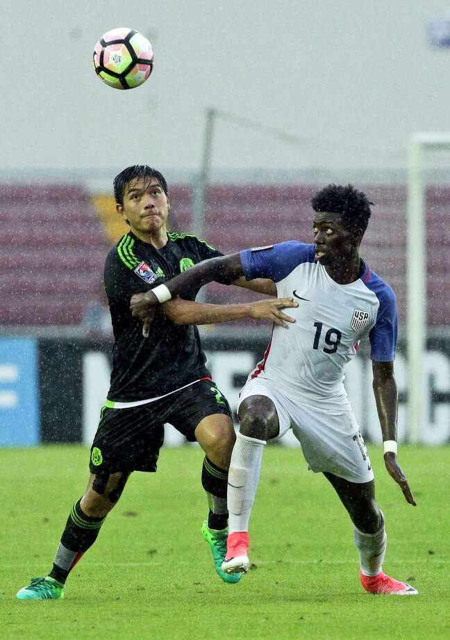 FILE - In this May, 7, 2017, file photo, United States' Tim Weah, right, and Mexico's Adrian Vazquez, fight for the ball during the final of the Concacaf under-17 soccer championship in Panama City. It's already been a busy year for Tim Weah. The 18-year-old received his first call-up to the United States national team weeks after debuting with Paris Saint-Germain, while also adjusting to his new role in the first family of Liberia as the son of President George Weah, the FIFA player of the year in 1995. (AP Photo/Arnulfo Franco, File) Photo: Arnulfo Franco / Copyright 2017 The Associated Press. All rights reserved.