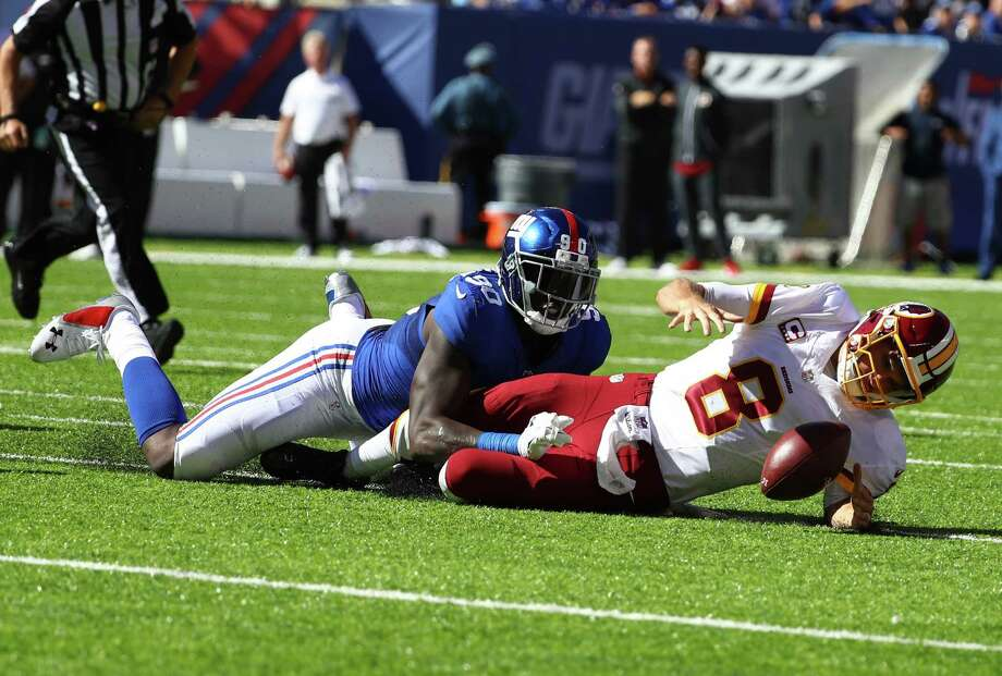 EAST RUTHERFORD, NJ - SEPTEMBER 25:  Kirk Cousins #8 of the Washington Redskins is sacked by  Jason Pierre-Paul #90 of the New York Giants in the second quarter during their game at MetLife Stadium on September 25, 2016 in East Rutherford, New Jersey.  (Photo by Al Bello/Getty Images) ORG XMIT: 659206667 Photo: Al Bello / 2016 Getty Images