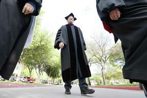 University of the Incarnate Word President Thomas Evans takes part in an academic procession through the center of the campus before his inauguration as the 10th president of UIW on Thursday.
