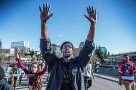Black Lives Matter supporters walk on to the northbound Interstate 5 on-ramp from I street during a rally for Stephon Clark, a man that was shot by Sacramento Police Sunday night on southbound Interstate 5 near Old Sacramento, on Thursday, March 22, 2018. (Hector Amezcua/Sacramento Bee/TNS)