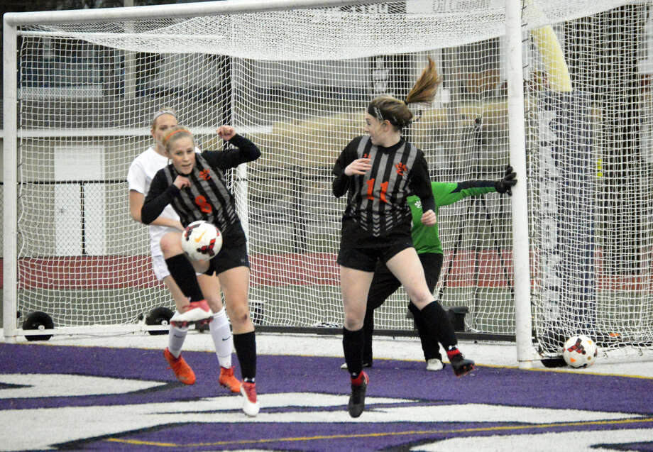 Edwardsville defender Sarah Kraus, left, clears a ball out of the 18-yard box with teammate Emma Hensley in on the play early in the first half of Thursday's Southwestern Conference game at Collinsville.