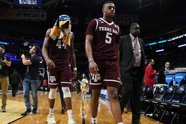 LOS ANGELES, CA - MARCH 22: Robert Williams #44 and Savion Flagg #5 of the Texas A&M Aggies walk off the court after their teams loss to the Michigan Wolverines in the 2018 NCAA Men's Basketball Tournament West Regional at Staples Center on March 22, 2018 in Los Angeles, California. The Michigan Wolverines defeated the Texas A&M Aggies 99-72.  (Photo by Harry How/Getty Images)