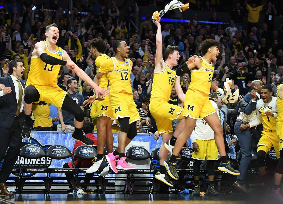 Michgan players celebrate a basket against Texas A&M late in the second half during an NCAA Tournament regional semifinal at Staples Center in Los Angeles on Thursday, March 22, 2018. Michigan advanced, 99-72. (Wally Skalij/Los Angeles Times/TNS)