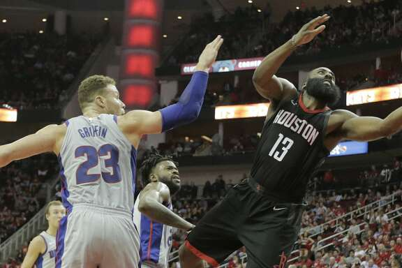 Houston Rockets guard James Harden (13) puts up two as he drives past Detroit Pistons forward Blake Griffin (23) at Toyota Center on Thursday, March 22, 2018, in Houston. Rockets won the game 100-96 in overtime. ( Elizabeth Conley / Houston Chronicle )