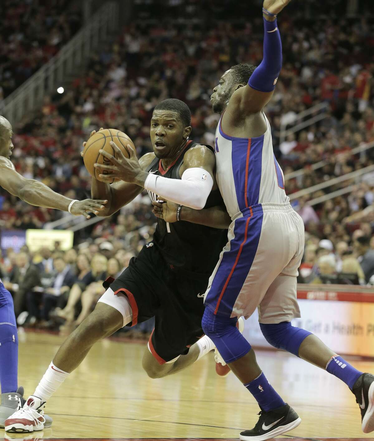 Houston Rockets guard Joe Johnson (7) drives to the basket past Detroit Pistons guard Reggie Jackson (1) at Toyota Center on Thursday, March 22, 2018, in Houston. Rockets won the game 100-96 in overtime. ( Elizabeth Conley / Houston Chronicle )