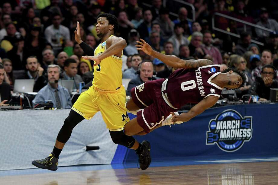 Jay Jay Chandler and the Aggies tumbled hard against Zavier Simpson and Michigan on Thursday night, falling way short in their bid to reach the Elite Eight for the first time. They trailed by 24 at the half and never mounted a serious comeback. Photo: Harry How /Getty Images / 2018 Getty Images
