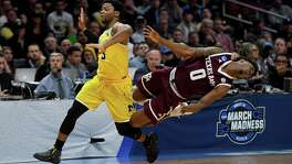 Jay Jay Chandler and the Aggies tumbled hard against Zavier Simpson and Michigan on Thursday night, falling way short in their bid to reach the Elite Eight for the first time. They trailed by 24 at the half and never mounted a serious comeback.