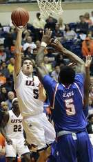 Giovanni Nicolao lofts a shot in over Josh Boutte as UTSA hosts Sam Houston State in the College Insider Tournament at UTSA on March 22, 2018.