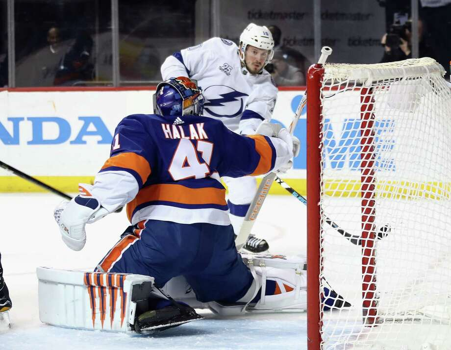 NEW YORK, NY - MARCH 22: J.T. Miller #10 of the Tampa Bay Lightning is stopped by Jaroslav Halak #41 of the New York Islanders during the third period at the Barclays Center on March 22, 2018 in the Brooklyn borough of New York City. The Lightning defeated the Islanders 7-6. (Photo by Bruce Bennett/Getty Images) Photo: Bruce Bennett / 2018 Getty Images