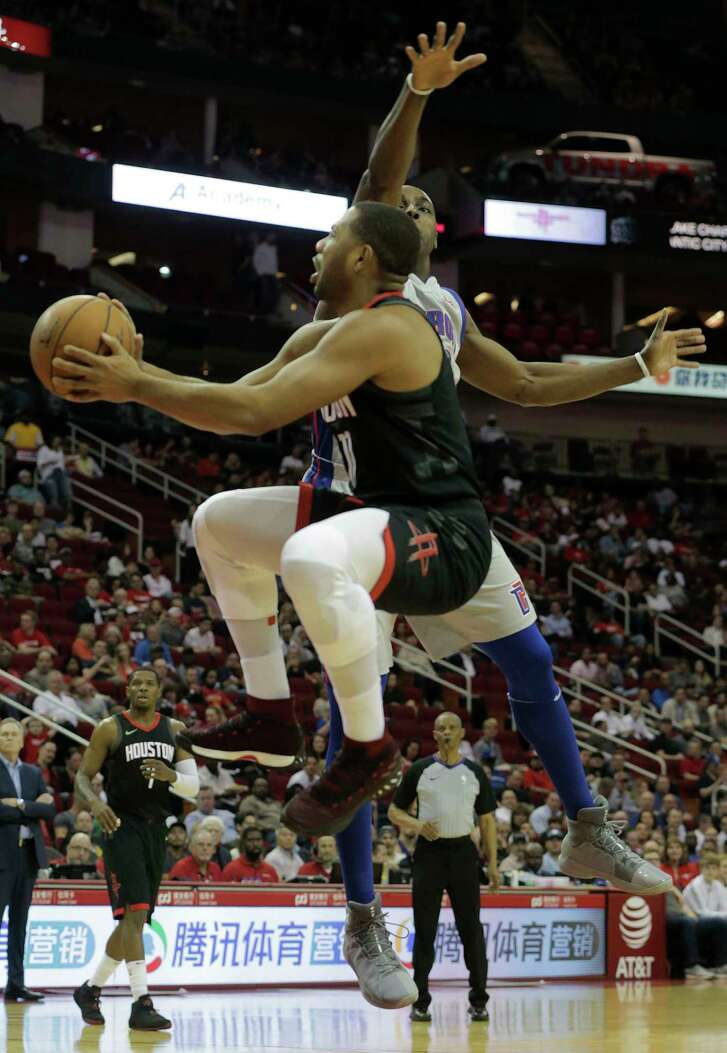 Rockets guard Eric Gordon gets a shot off against  Pistons forward Anthony Tolliver, right. Gordon led the Rockets with 22 points.