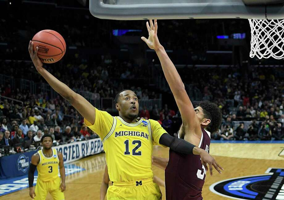 Michigan guard Muhammad-Ali Abdur-Rahkman (12) shoots against Texas A&M during the first half of an NCAA men's college basketball tournament regional semifinal Thursday, March 22, 2018, in Los Angeles. (AP Photo/Jae Hong) Photo: Jae Hong / Copyright 2018 The Associated Press. All rights reserved.