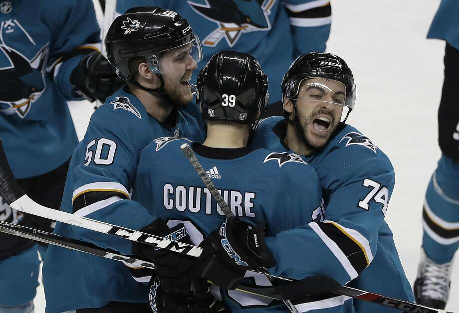 San Jose's Logan Couture celebrates Dylan DeMelo (74) and Chris Tierney (50) after scoring the winner against Vegas in overtime at SAP Center. Photo: Marcio Jose Sanchez, Associated Press