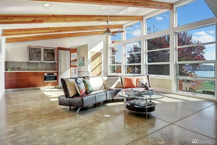 With sweeping lake views, a private dock, game room and theater, this award-winning Mercer Island contemporary asks $5.280M. Photo: Jane Potashnick/Coldwell Banker Bain